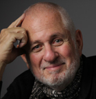 Richard Saul Wurman encourages the design community to take initiative and solve big problems rather than make small changes incrementally.