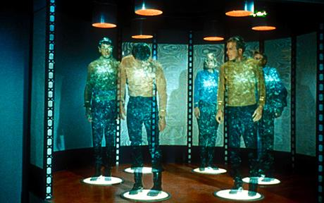 Image 7: In Star Trek, crew members of the USS Enterprise stand on transporter platforms to be beamed down to a nearby planet.