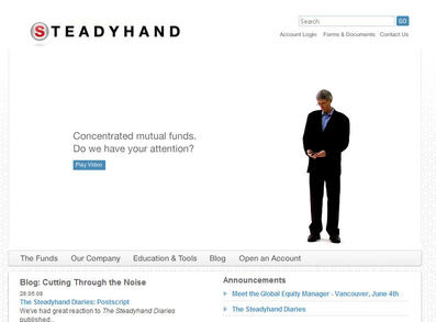 Steadyhand's CEO checks his phone while he waits for the user to interact with him, like a game character waiting for a player to start