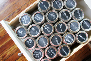 Photo of labeled spice jars in a drawer.