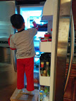 The son raiding the refrigerator. Credit: Grace G Lau