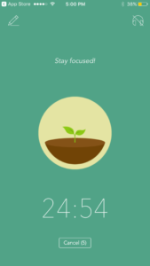 "An in-app screen, encouraging the user to ""Stay focused!"" with a countdown timer and image of a growing sapling."