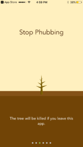 "Screen three of the tutorial. Text says ""Stop Phubbing. The tree will be killed if you leave this app."""