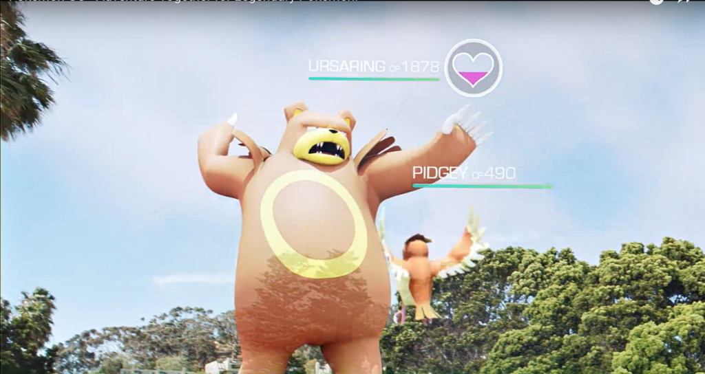 Image shows a capture from a Pokemon Go experience, showing two characters with trees and sky in the background.