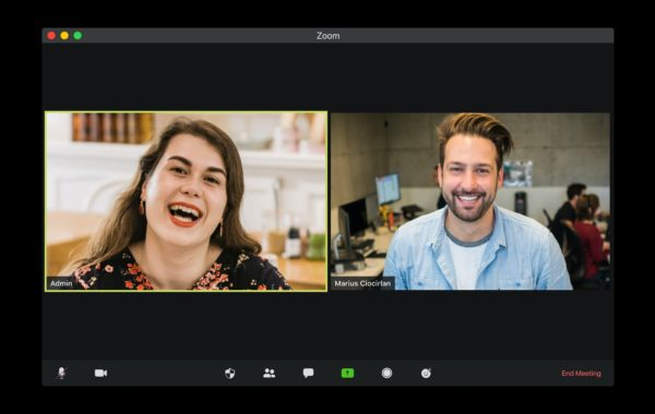 a woman and man on a video conference