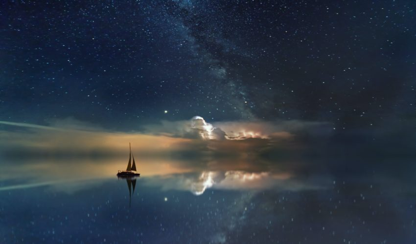 sailboat on the sea, under the stars at night